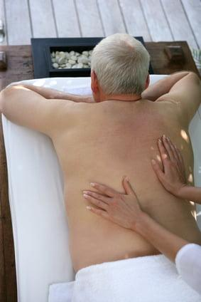 Senior man receiving a back massage